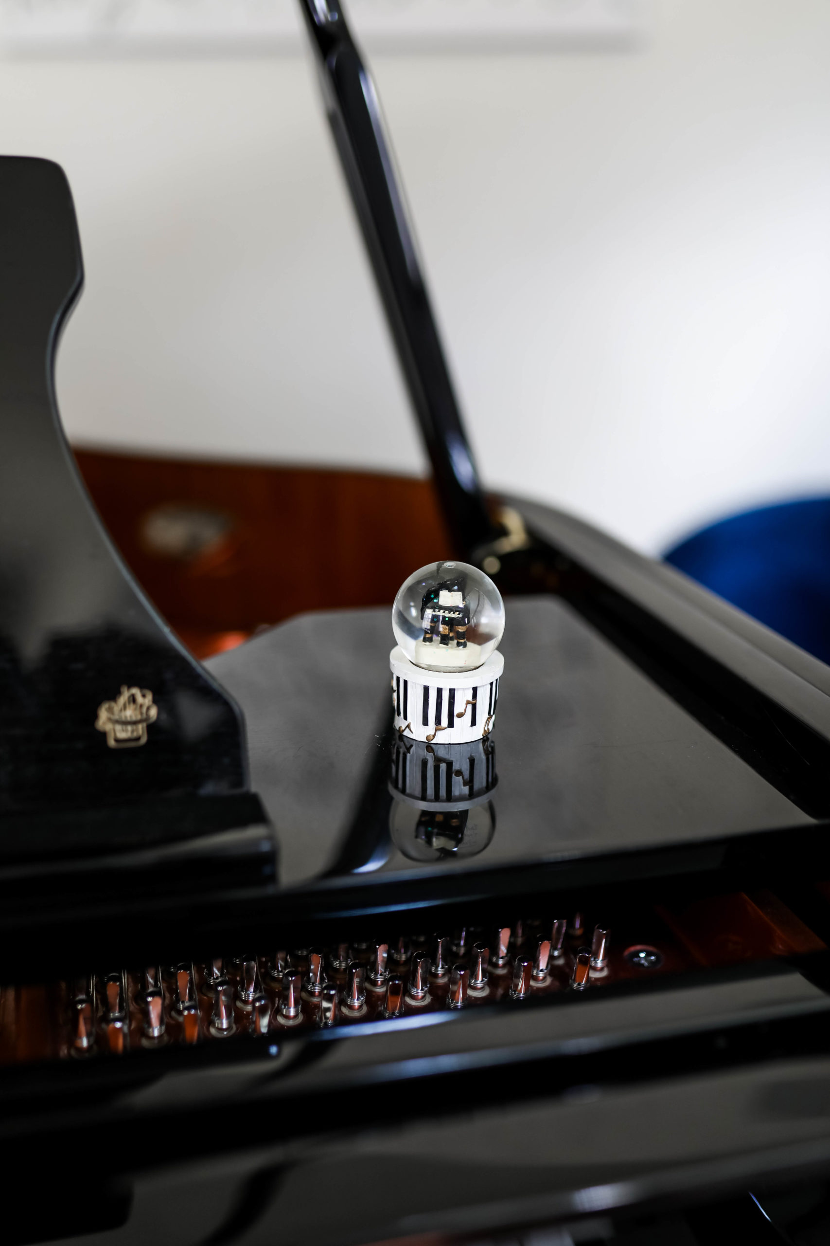 musical snow globe sitting on a piano