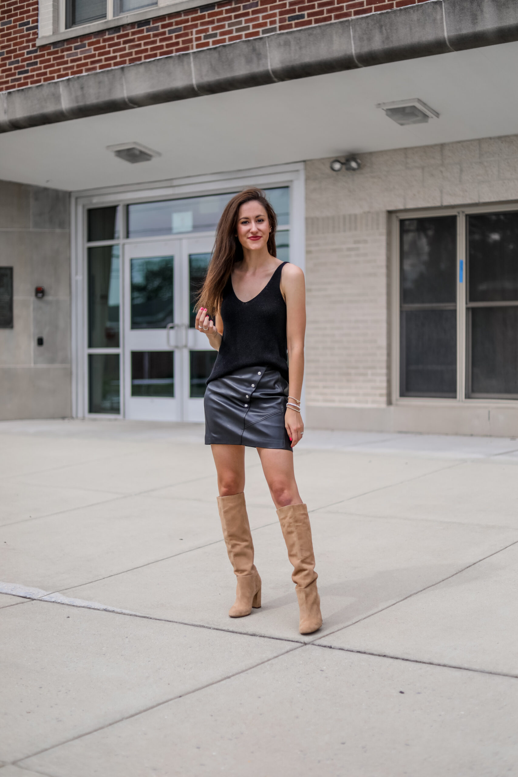 Faux leather skirt + sweater tank outfit on Coming Up Roses
